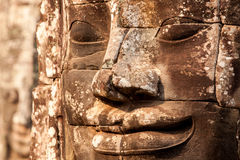 Faces of Bayon Temple. Stone faces of Bayon Temple in Angkor Thom, Siem Reap, Cambodia. Selective focus Royalty Free Stock Image