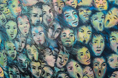 Faces on the Berlin wall. A graffiti of faces on the Berlin wall Stock Image