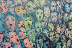 Faces on the Berlin wall. A graffiti of faces on the Berlin wall Royalty Free Stock Photography