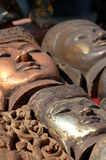 The Faces of the Buddha. Buddha masks made out of wood for sale at an outdoor market in Burma (Myanmar royalty free stock photography