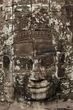 1000 faces of Buddha temple. Closeup of a sculpted face on the 1000 faces of Buddha temple in the Bayon complex at Angkor in Cambodia Royalty Free Stock Images