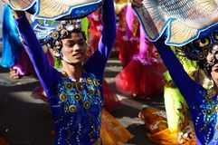 Faces of carnival dancers in various costumes dancing along the road Stock Images