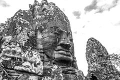 Face carved in a Rock in Angkor Wat royalty free stock photos