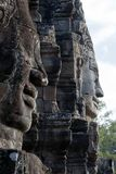 Faces carved into stone at the Bayon Wat in late afternoon sunlight, a 12th century temple within the Angkor royalty free stock photography
