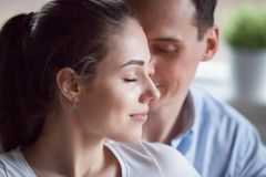 Faces of couple in love with closed eyes stock photography