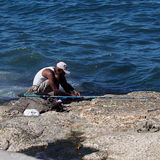 Faces Of Cuba-Fisherman Along The Malacon Stock Photo