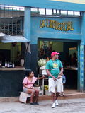 Faces Of Cuba-Man And Woman In Doorway Of Shop Royalty Free Stock Photo
