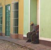 Faces Of Cuba Men In Doorway In Trinidad Royalty Free Stock Photography