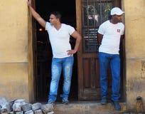 Faces Of Cuba-Men In Doorway Stock Images