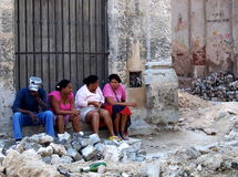 Faces Of Cuba-People Resting In Doorway stock photography