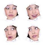Faces da menina em um furo de papel Fotografia de Stock Royalty Free