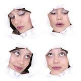 Faces da menina em um furo de papel imagem de stock royalty free