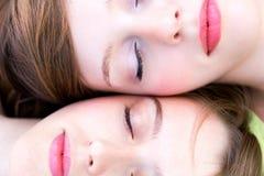 Faces de duas mulheres Fotografia de Stock Royalty Free