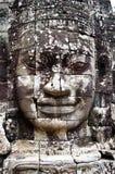Faces de sorriso no templo de Bayon Fotografia de Stock