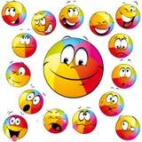 Faces dos desenhos animados da esfera de praia Imagem de Stock