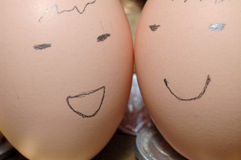 Faces drawn on brown eggs Stock Photo