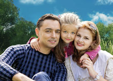 Faces family with little girl in park collage royalty free stock images