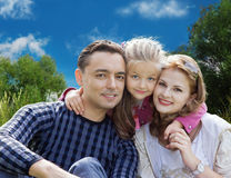 Faces family with little girl in summer park. Collage Royalty Free Stock Image