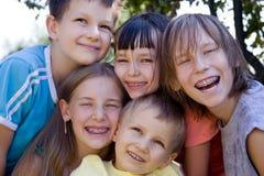 Faces felizes das crianças Foto de Stock Royalty Free
