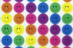 Faces felizes no vidro fronteado Imagens de Stock Royalty Free