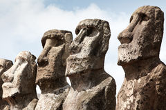 Faces of four moai in Easter Island. Faces of four stone moai in Easter Island on sunny day royalty free stock photography