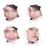 Faces of the girl in a paper hole. Faces of the girl in a white paper hole Royalty Free Stock Photo