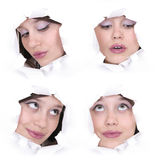 Faces of the girl in a paper hole Royalty Free Stock Image