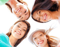 Faces of girls looking down and smiling Stock Photography
