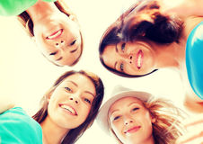 Faces of girls looking down and smiling Royalty Free Stock Photography