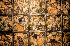 Faces of historical persons on patterned ceramic tiles in traditional style, made in 18th century royalty free stock photos