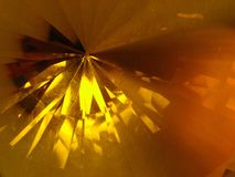 Facets of light gold crystal stock image
