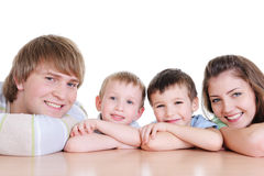Faces of members of young loving family Stock Images