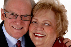 Faces of middle age couple. Stock Photo