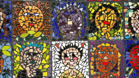 Faces in Mosaic. Differing ethnic faces set in tile for mosaic art form Stock Image