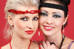 Faces Of The Two Fashion Models Stock Photography