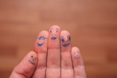 Faces painted on fingers. Family stock photography