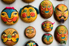 Faces painted on woven round bamboo trays in Hanoi Royalty Free Stock Photography