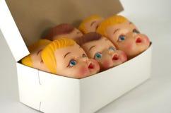 Faces plásticas da boneca Fotos de Stock