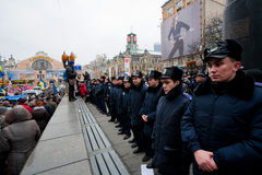 Faces of the police forces guarding the last monument of the communist leader Lenin during the pro-European protest Royalty Free Stock Photos