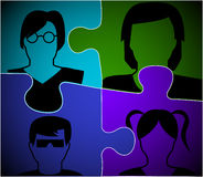 Faces on puzzle pieces Stock Images