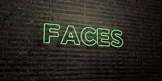 FACES -Realistic Neon Sign on Brick Wall background - 3D rendered royalty free stock image Stock Photo