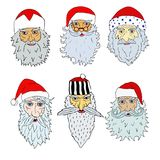 Faces of Santa Clauses of different countries. On transparent background Stock Photos
