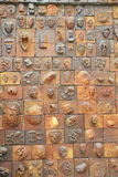 Faces. Sculpted faces on a wall in Fosan Stock Photography
