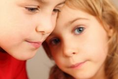 Faces of two children. focus on little boy's eye. Stock Photos