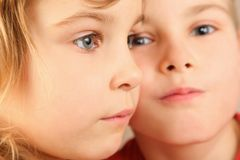 Faces of two children. focus on little girl's eye Stock Photo