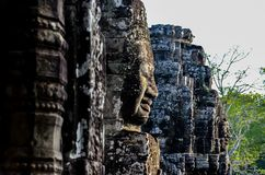 Faces on walls in Cambodia stock photography