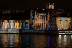 Faces on the walls of Cathedral and buildings. LYON, FRANCE, December 8, 2015 : With numerous small lights, the festival of lights 2015 pays tribute to the stock photography