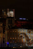 Faces on the walls. LYON, FRANCE, December 8, 2015 : The traditional festival of the lights, cancelled after the attacks of Paris, is replaced by a tribute in royalty free stock photos