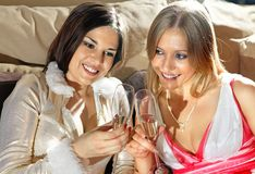 Faces of women with glasses of wine Stock Image
