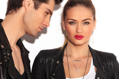 Faces of a young couple in leather jackets Royalty Free Stock Images